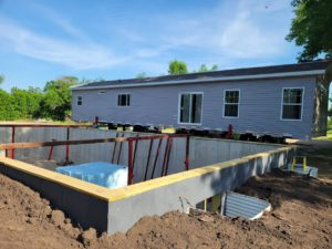 Replacing an old farmhouse with a modular home